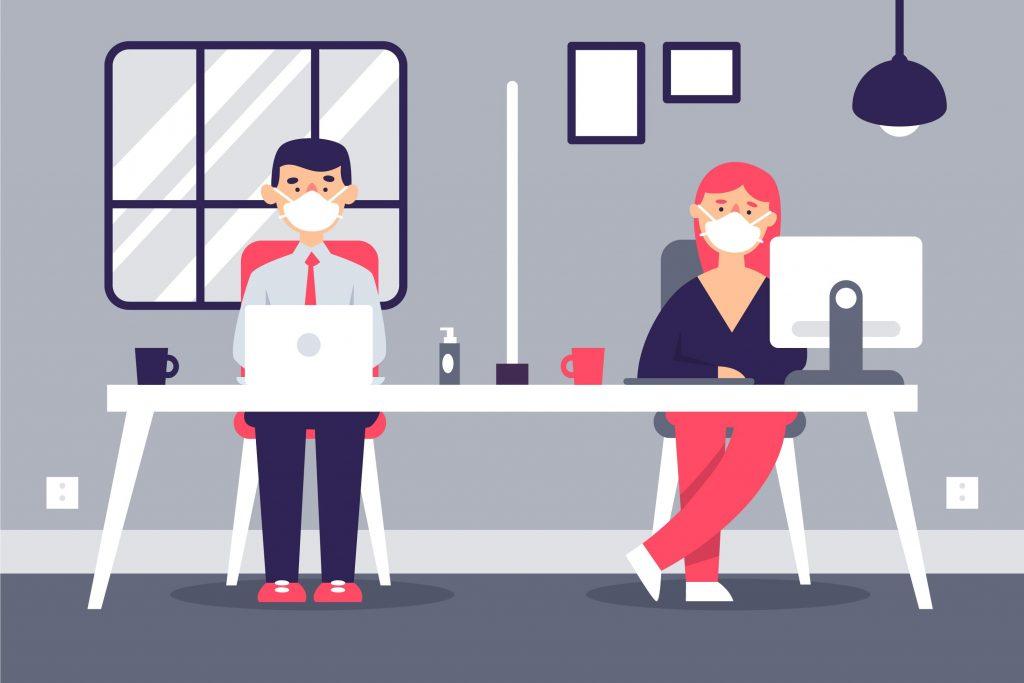 Personnes masquées dans un bureau